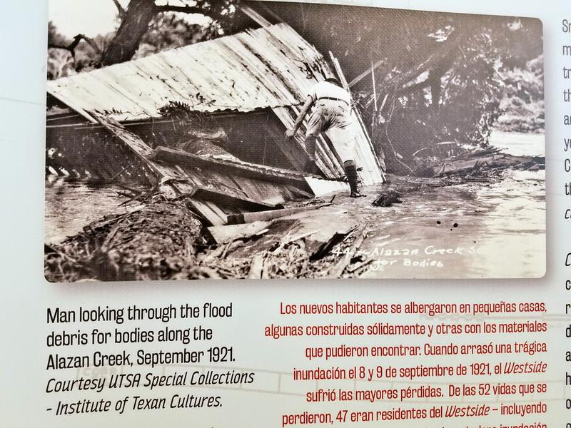 An exhibit panel highlighting the 1921 flood that killed dozens on San Antonio's West Side and led activists to lobby for public housing.