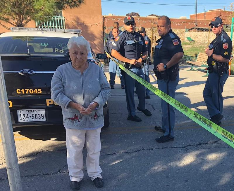 """Antonia Morales, 90, resident of Barrio Duranguito for over forty years, stands in front of El Paso Police Department officers sent to """"protect the workers"""" putting up a fence that cut the neighborhood in half."""