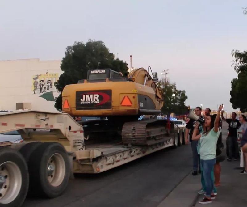Supporters and residents stop bulldozers from entering Barrio Duranguito on September 11, 2017 while attorneys defending the barrio were in court.