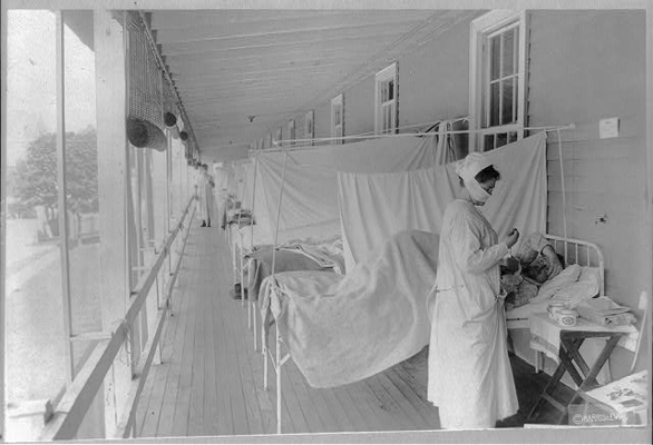 A nurse takes a patient's pulse in the influenza ward at Walter Reed Hospital in Washington, D.C., on Nov. 1, 1918. Health experts – including those in San Antonio – believed fresh air would help prevent the spread of the disease.
