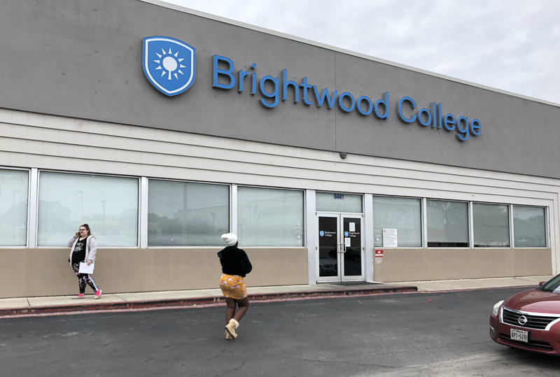 Students pick up transcripts at the Ingram campus of Brightwood College San Antonio after learning their school was closing Dec. 5 2018.
