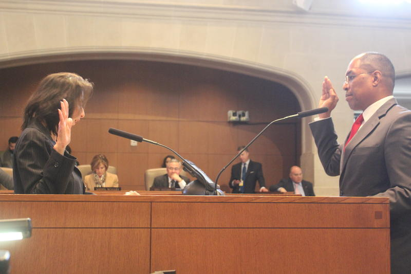 Art Hall, 48, takes the oath of office administered by City Clerk Leticia Vacek