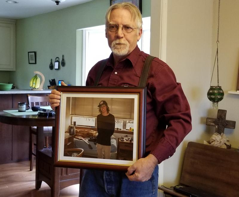 Robert Dyer holds a photo of his son Graham, who died while in the custody of the Mesquite Police Department.