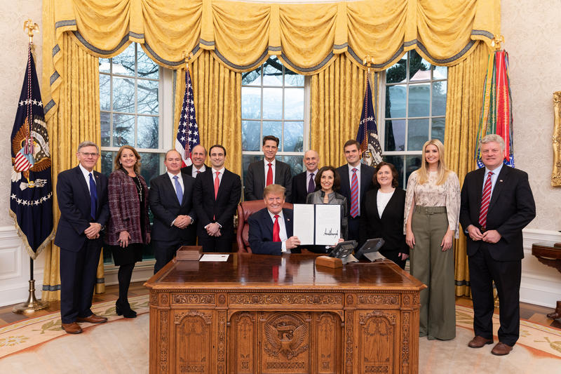 "President Donald Trump signs the ""Maintaining American Leadership in Artificial Intelligence"" Monday, Feb. 11, 2019, in the Oval Office of the White House."