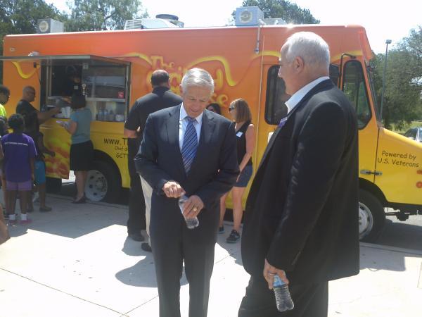 General Wesley Clark (left) unveils Grilled Cheese Trucks for veteran jobs.
