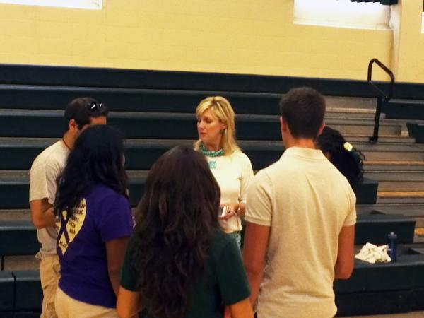 Counselor Becky Smith talks with Cole High School students before the start of the school year.