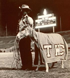 UTEP's first mascot with Clyde the burro