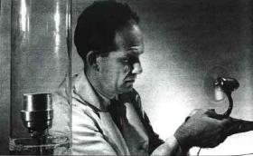 In this 1963 photograph, Ben Abeles demonstrates how the silicon-germanium alloys he and George Cody developed could convert heat directly into electricity, which in this case was used to power a small fan.