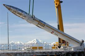 A large crane slowly lifts a ground-based interceptor at Fort Greely's missile base. The base, which has about 25 missiles in silos, is the hub of the U.S. military's ground-based midcourse missile defense system.