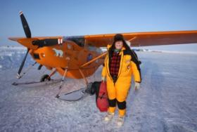 Art Mortvedt prepares to put an engine cover on his Cessna 185 -- a.k.a. the Polar Pumpkin -- at 2 p.m. April 7, shortly after arriving at Russian Ice Station Barneo, where he landed after flying over the North Pole, 20 miles away.