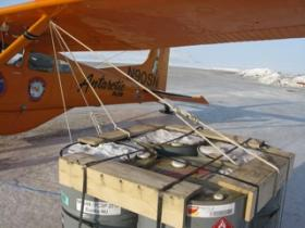 At the Eureka Weather Station on Ellesmere Island, in far northern Canada, Mortvedt tied-down his Cessna on both sides with several ropes attached to four fuel drums to secure the aircraft against the High Arctic's ferocious winds.