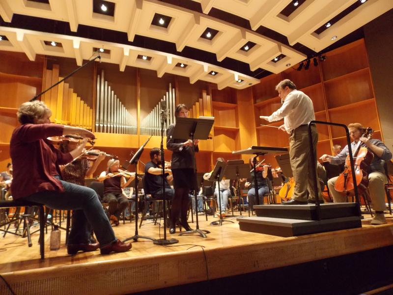 "Eduard Zilberkant directs singer Marleen Bateman and the Fairbanks Symphony during a ""Song of the Sikuliaq"" practice session at U.A.F.'s Davis Concert Hal