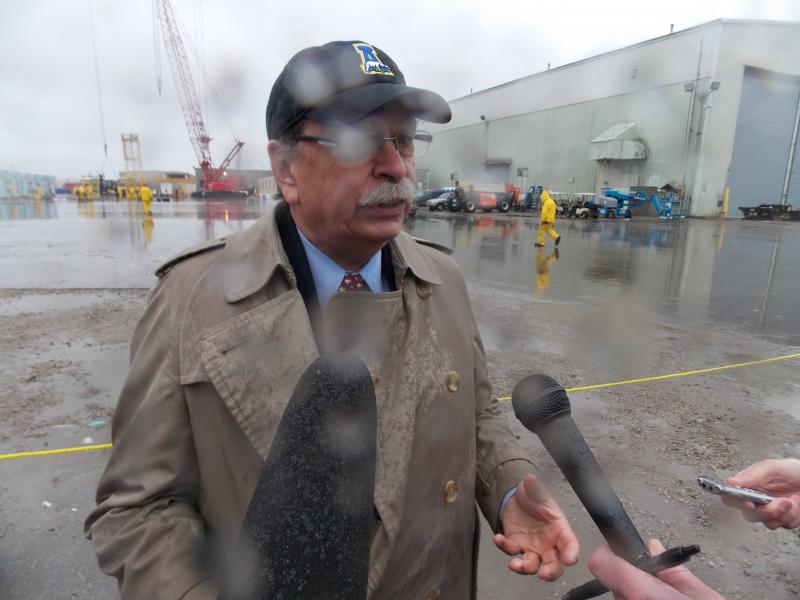 U.A.F. Chancellor Brian Rogers at rainy post launch press conference.