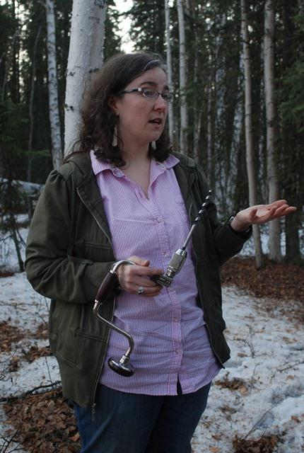 Kimberly Maher holds a drill she'll use to tap an Alaskan birch.