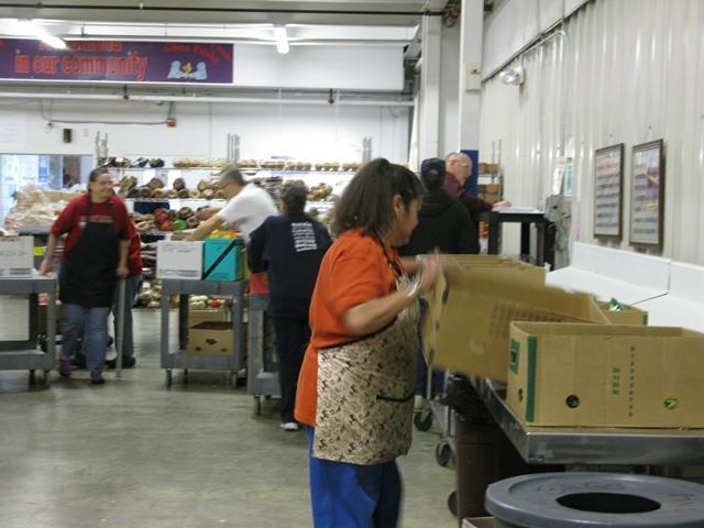 Voluteers organize boxes that will go out for Thanksgiving.