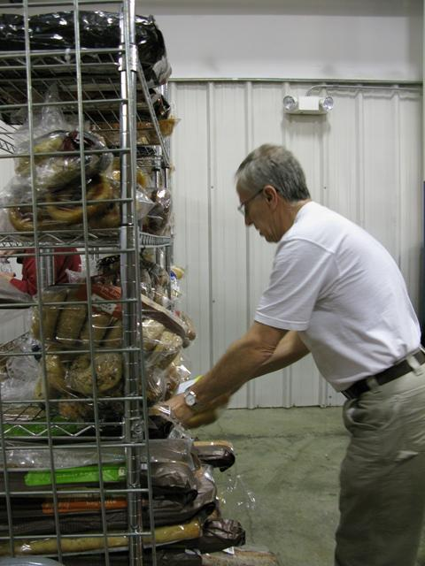Volunteer Ted Johnson sorts bread before items are boxed up for donation.