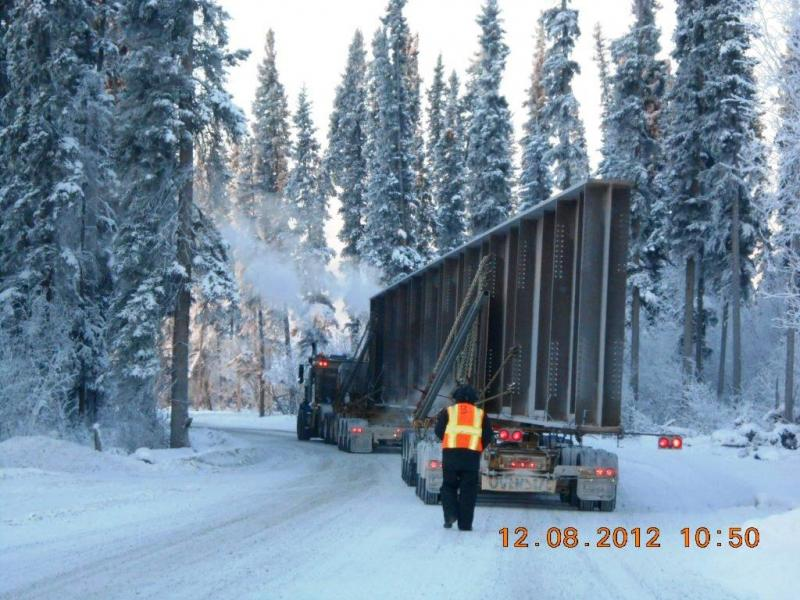 The drivers of the tractor-trailer rigs hauling the 165-foot bridge girders had to slowly and carefully snake their way through a series of twists and turns on the road leading to the Alaska Railroad's Tanana River Crossing construction site in Salcha.