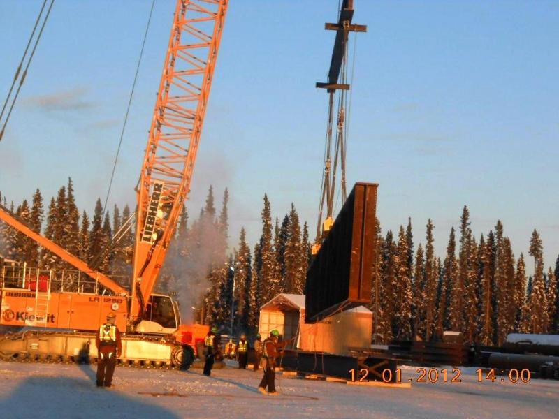Once unloaded, the girders are stored at the bridge construction site until workers begin to assemble the permanent Tanana River Crossing bridge structure beginning in spring 2013. The empty trucks head back to Valdez for another load of girders.
