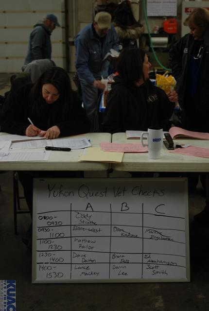 Volunteers help keep veterinarians and mushers organized.