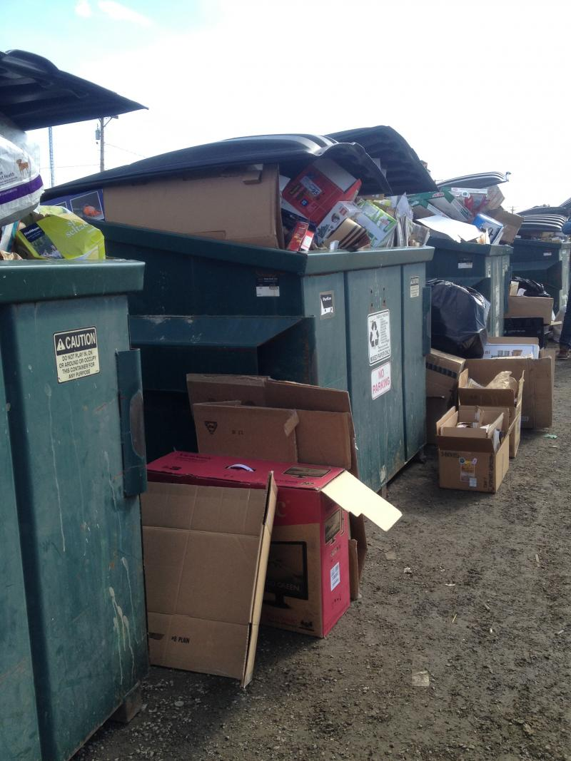 Dumpsters for cardboard are overflowing.