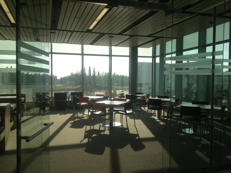 Wide, open conference spaces and meeting places are meant to foster converstaion about research