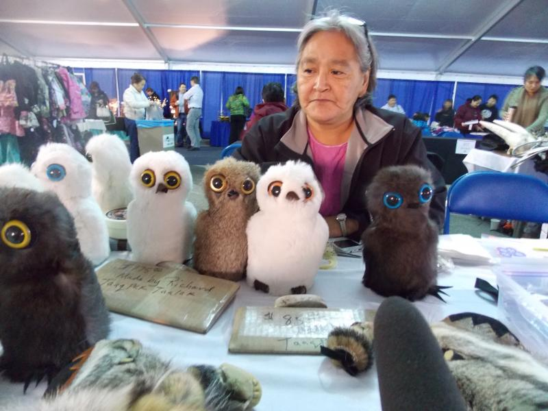 Barrow's Mable Smith and the Snowy Owl dolls she makes.