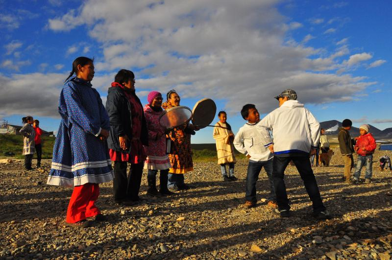The residents of Novoye Chaplino greeted vistors when they arrived on the beach with traditional song and dance.