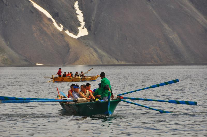 Men line up their boats in Tkachen Bay for the walrus skin boat race