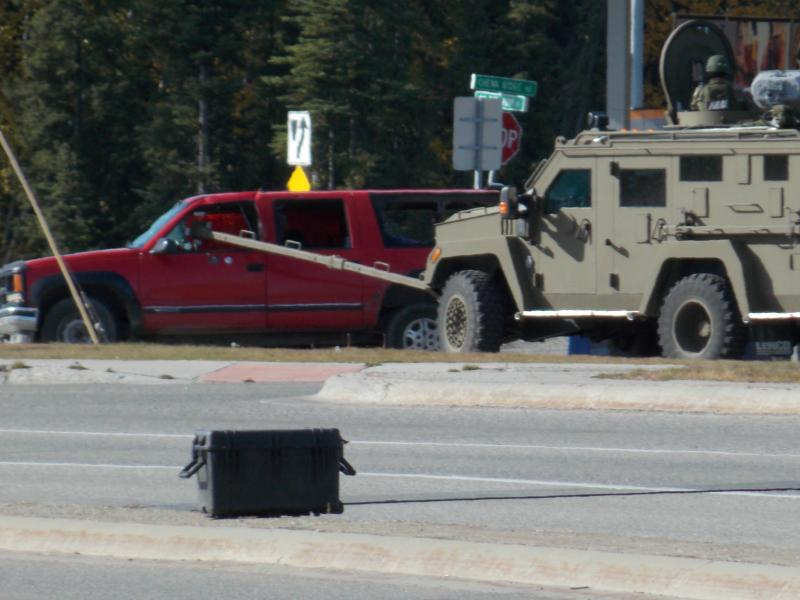 "Police use armored ""Bearcat"" to break out windows on Bracht's SUV."