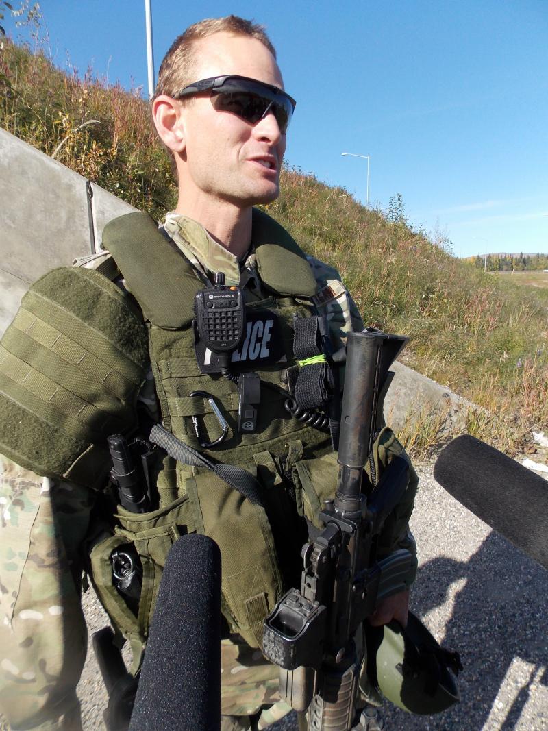 Fairbanks Police tactical team commander lieutenant Eric Jewkes talks to media post standoff.