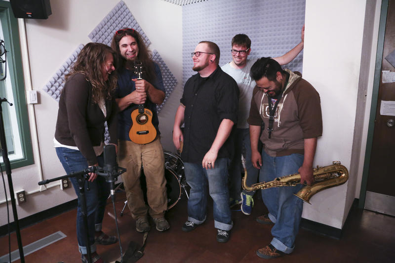 Host Lori Neufeld cracks up with Ukulele Russ, drummer Anthony Smith, bassist Jeremiah Bakken and saxophonist Frank Gamboa