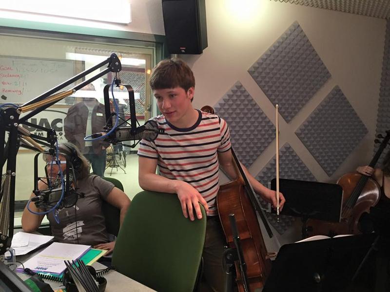 Alaska Cello Student Mac Levey on the microphone