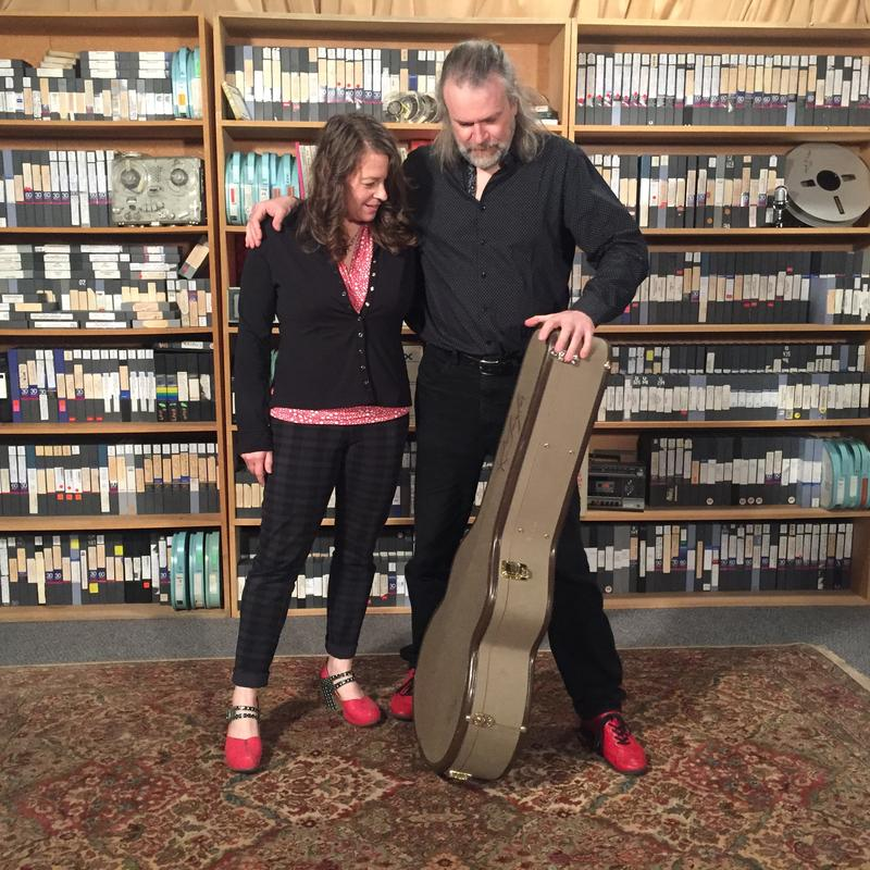 Host Lori Neufeld and guest Beppe Gambetta admiring shoe choices