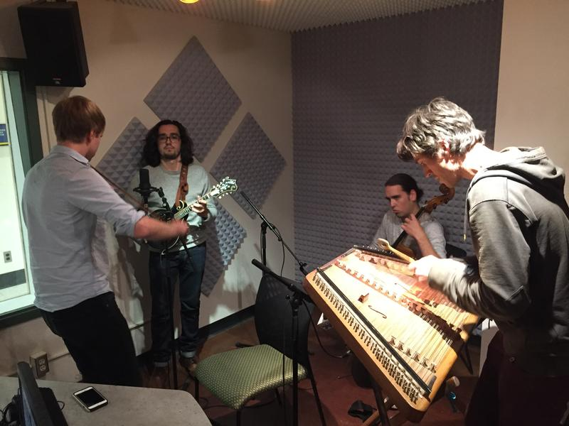 The Jeremy Kittel Band clusters around the KUAC mics
