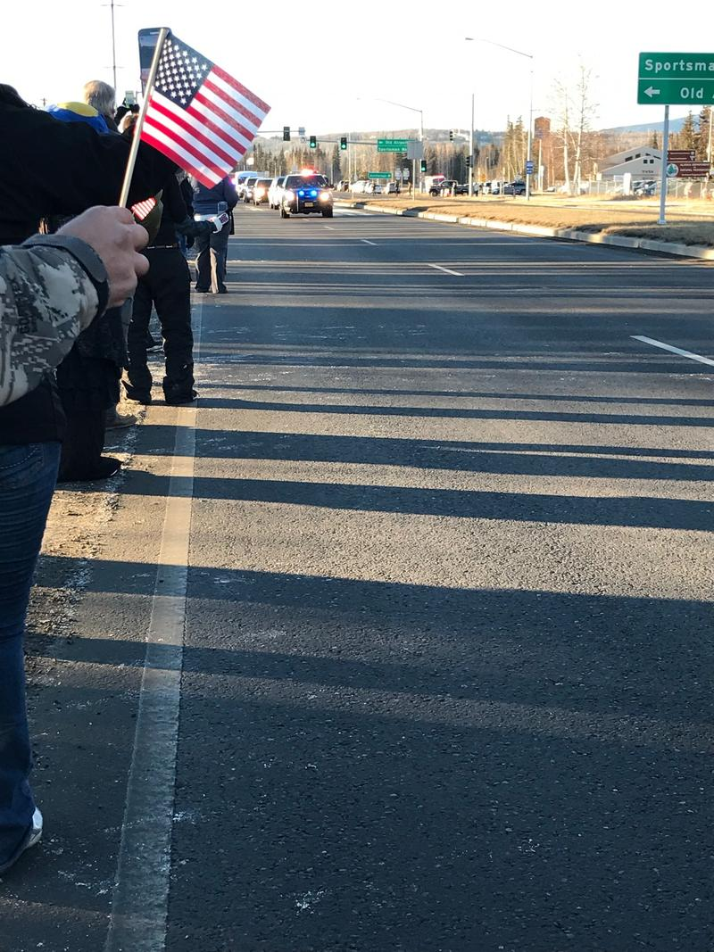 A flag is waved in honor of Sargent Allen Brandt