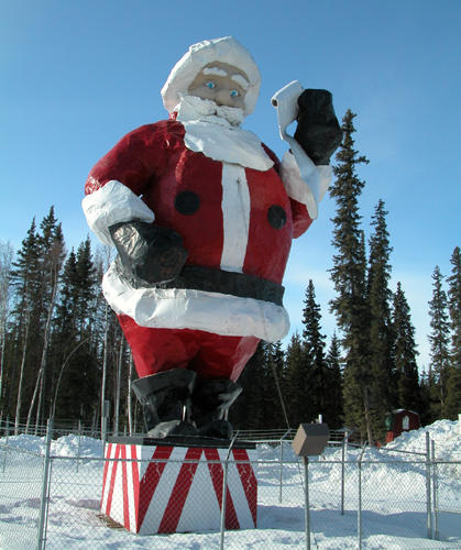 the nearly 50 foot hollow fiberglass statue has kept his list of whos naughty and whos nice in north pole since 1984 - Santa And The North Pole