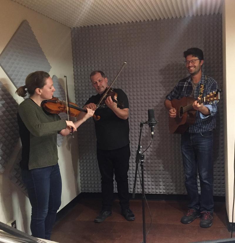 Caitlin Warbelow, fiddle; Troy MacGillivray, fiddle; Louis Charles Vigneau, guitar