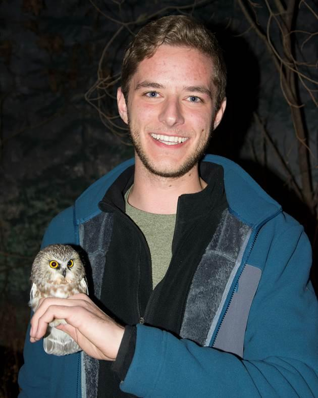Mitchell Pruitt with the first northern saw-whet owl caught in Arkansas.