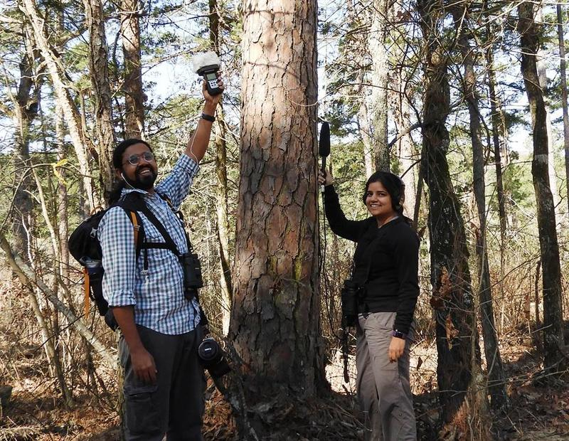 Anant Deshwal and Pooja Panwar pose while recording birds on the Ozark National Forest.