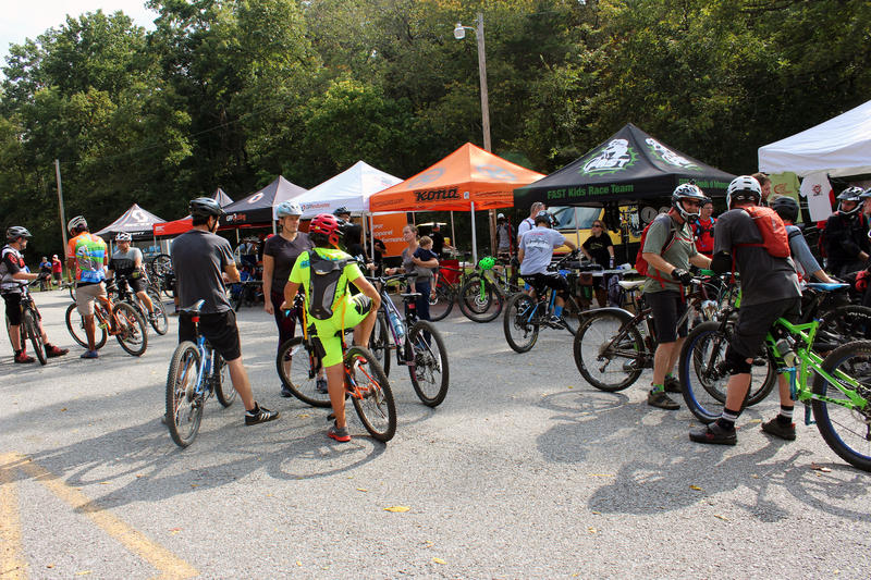 Bicyclists gather during the grand opening of the Back 40 trail system in Bella Vista.
