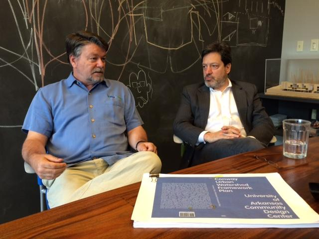 Marty Matlock, executive director of the Office of Sustainability at the University of Arkansas, discusses Conway's urban watershed plan with Stephen Luoni, executive director of the University of Arkansas Community Design Center in downtown Fayetteville.