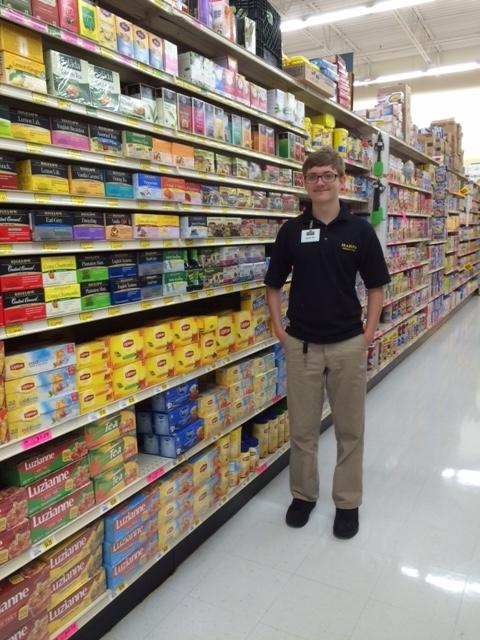 """PROMISE youth, Zachary McCoy """"faces"""" inventory at a Harp's store in Rogers."""