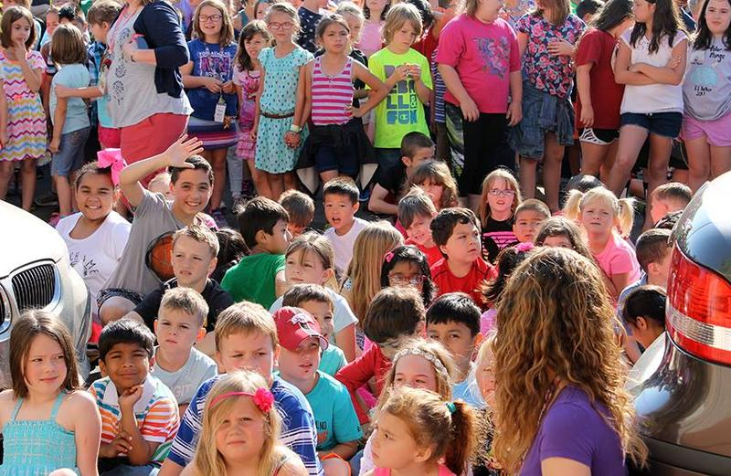 Bentonville public school children assembled outdoors for a special event last school year.