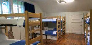 A men's dormitory inside Little Rock Firehouse Hostel sleeps more than a dozen.