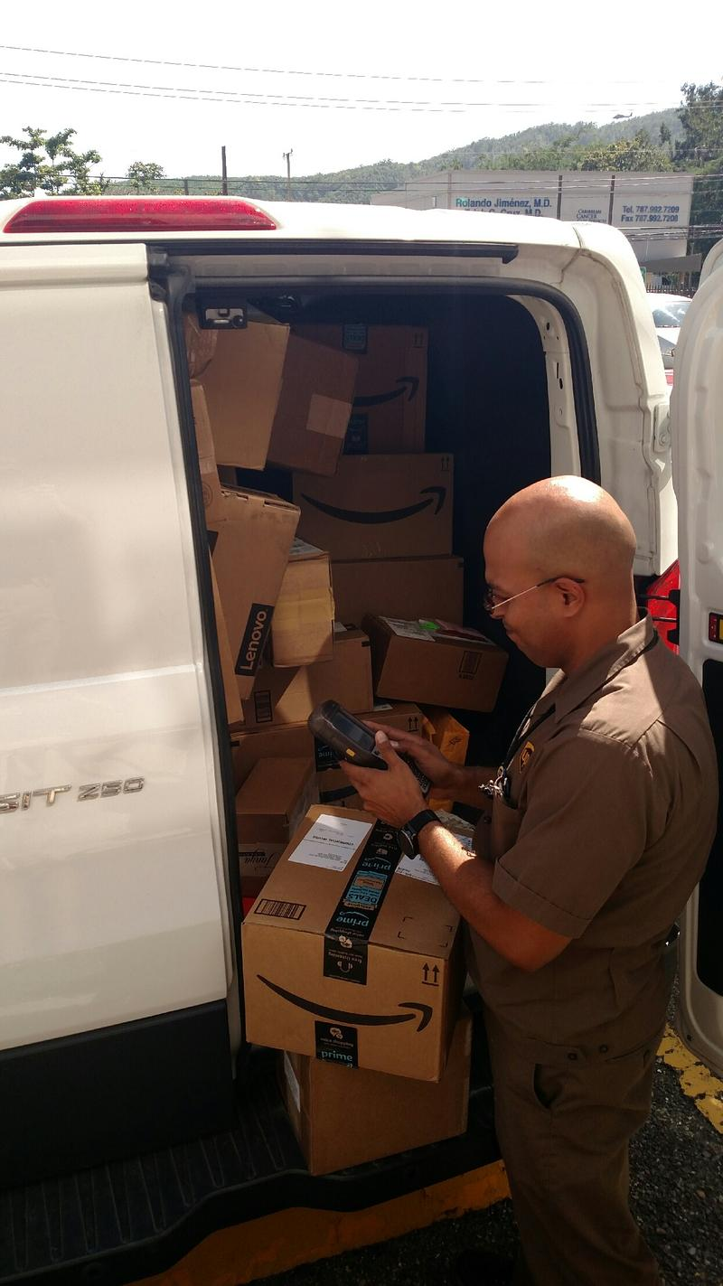 A delivery of Amazon boxes filled with everyday necessities arrives at one of the dialysis clinics.