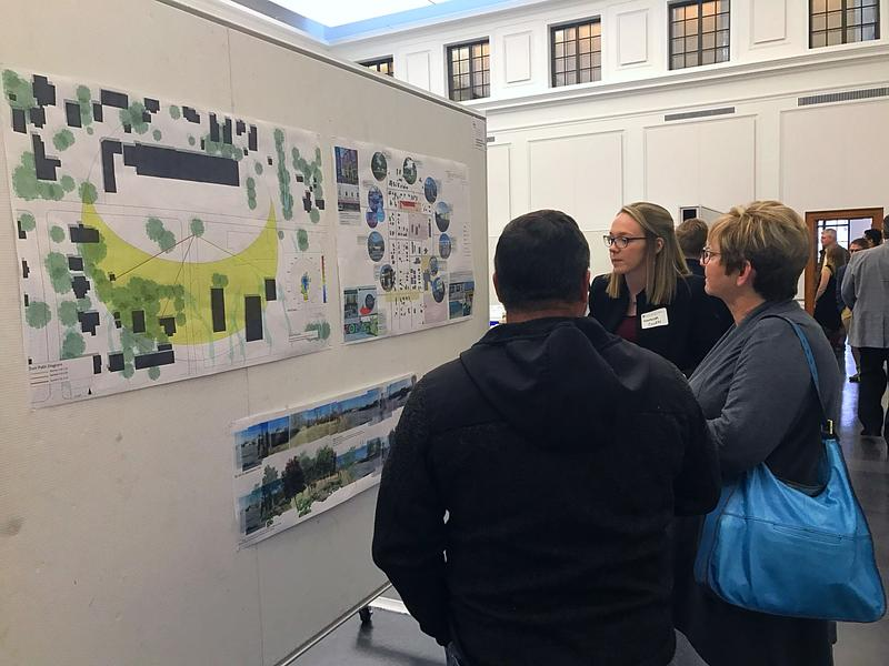 Students from the studio course discuss their affordable housing projects during Sunday's events at Vol Walker Hall on the U of A campus.