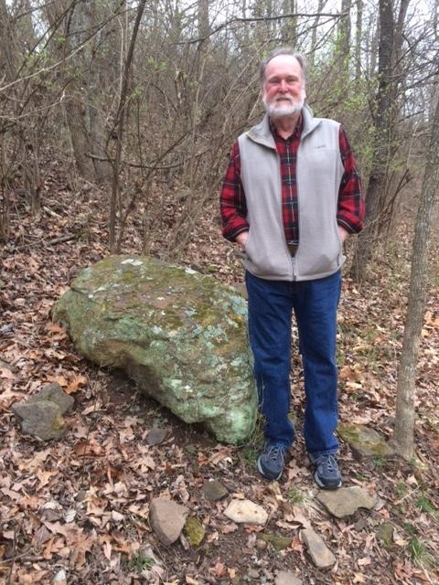 Kimberly Smith stops by a boulder in Mount Sequoyah Woods to talk skunks.