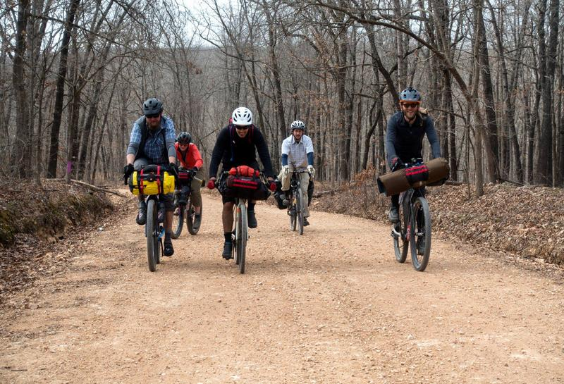 Five members of the group of eight who rode 140 miles of the 1,400-mile route.