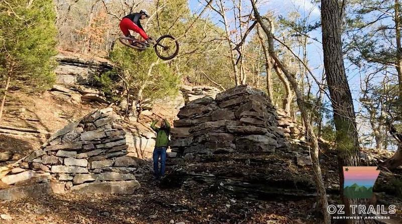 Gary Vernon of the Walton Family Foundation tests a gap jump on one of the new downhill trails at Lake Leatherwood City Park.