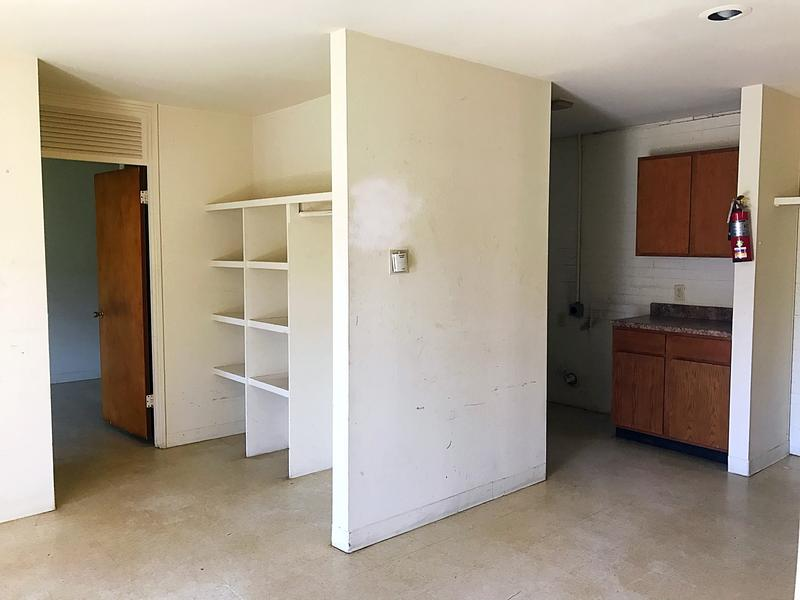 The living room area in a unit at Lewis Plaza. The building where the unit is located will likely have to be torn down.